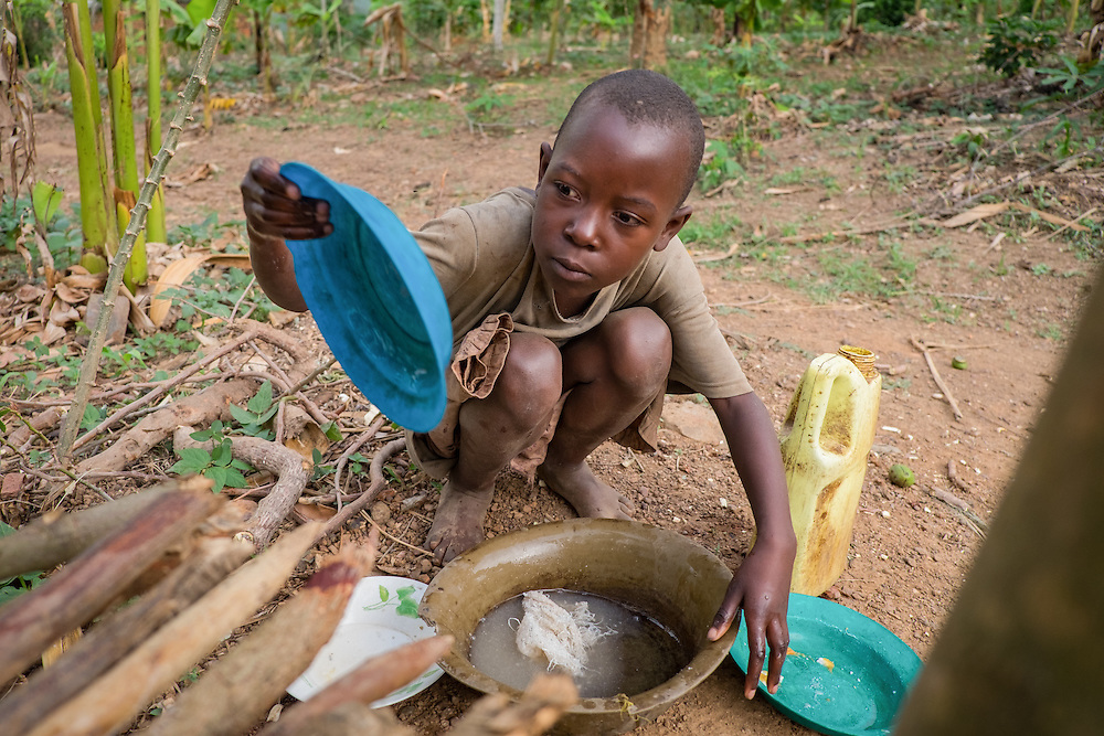 CAPTION: Veronica, who is eight years old, performs her daily chores before preparing for school in the morning. SignHealth Uganda assists parents in understanding the nature of hearing impairment, which is traditionally seen as a bad omen on the family. It also helps them to realise that hearing impaired children are still capable of normal, happy lives both at home and at school. LOCATION: Lutungu Village, Rakai District, Central Region, Uganda. INDIVIDUAL(S) PHOTOGRAPHED: Veronica Nampijja.