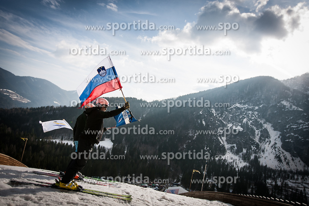 Flag holder with Slovenian national flag during Large Hill Individual Event at 3nd day of FIS Ski Jumping World Cup Finals Planica 2014, on March 22, 2014 in Planica, Slovenia. Photo by Grega Valancic / Sportida