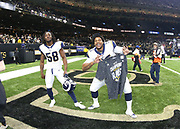 Jan 20, 2019; New Orleans, LA, USA; Los Angeles Rams inside linebacker Cory Littleton (58) and defensive tackle Ethan Westbrooks (95) celebrate after winning the NFC Championship against the New Orleans Saints at Mercedes-Benz Superdome. The Rams beat the Saints in overtime 26-23 and head to Super Bowl 53 in Atlanta. (Steve Jacobson/Image of Sport)
