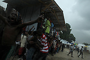 Port Au Prince, Haiti 073110  Soccer game spectators at the  St. Therese Park tent city in Petion Ville, Haiti react to afternoon showers which interrupted a match on July 31, 2010. (Essdras M Suarez/ Globe Staff)/ MET
