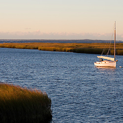 Sailboat and salt marsh at the mouth of the Connecticut River in Old Lyme, Connecticut.  Long Island Sound.
