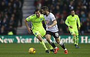 Derby County midfielder Jacob Butterfield gets away from Brighton striker, Tomer Hemed (10) during the Sky Bet Championship match between Derby County and Brighton and Hove Albion at the iPro Stadium, Derby, England on 12 December 2015.