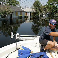 NEW ORLEANS, LA - September 4, 2005:  Volunteer firefighters search flooded New Orleans, LA on Sept. 4, 2005 for survivors of Hurricane Katrina. (Photo by Todd Bigelow/Aurora)
