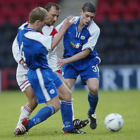 Airdrie v St Johnstone..  25.01.03<br />Jerome Vareille is closed down by Marc McCulloch and Ross Forsyth<br /><br />Pic by Graeme Hart<br />Copyright Perthshire Picture Agency<br />Tel: 01738 623350 / 07990 594431