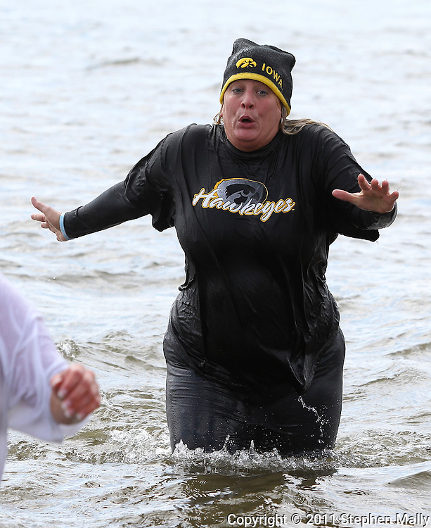 Tania Kaas, of Cedar Rapids, reacts to the cold water at the Polar Plunge event at Pleasant Creek State Recreation Area in Palo on Saturday March 26, 2011. 28 team participated in the event which was sponsored by local law enforcement agencies and raised money for Special Olympics Iowa.