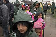 Greece, Idomeni, Refugees on their way to Europe,   Children in Idomeni<br /> <br /> Idomeni, is the eye of a needle for getting to nothern Europe. <br /> Children from Syria, Afghanistan and Irak are waiting in the rain in a line for food supply in Idomeni.<br /> <br /> <br /> Nadeloehr nach Nordeuropa Idomeni, der Grenzuebergang ist seit Wochen gesperrt,. <br /> Regen und Kaelte machen vor allem den Familien mit kleinen Kindern zu schaffen. <br /> <br /> <br /> <br /> <br /> keine Veroeffentlichung unter 50 Euro*** Bitte auf moegliche weitere Vermerke achten***Maximale Online-Nutzungsdauer: 12 Monate !! <br /> <br /> for international use:<br /> Murat Tueremis<br /> C O M M E R Z  B A N K   A G , C o l o g n e ,  G e r m a n y<br /> IBAN: DE 04 370 800 40 033 99 679 00<br /> SWIFT-BIC: COBADEFFXXX