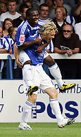 Peterboro Utd FC vs Sheffield Wednesday FC Championship 15/08/09<br /> Photo Nicky Hayes/Fotosports International<br /> Craig Mackail-Smith gives Aaron McLean a lift after scoring Peterboro's equaliser.