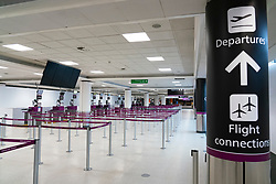 Edinburgh, Scotland, UK. 27 March, 2020. Interior views of a deserted Edinburgh Airport during the coronavirus pandemic. With very few flights during the current Covid-19 crisis passengers are scarce in the terminal building. Iain Masterton/Alamy Live News