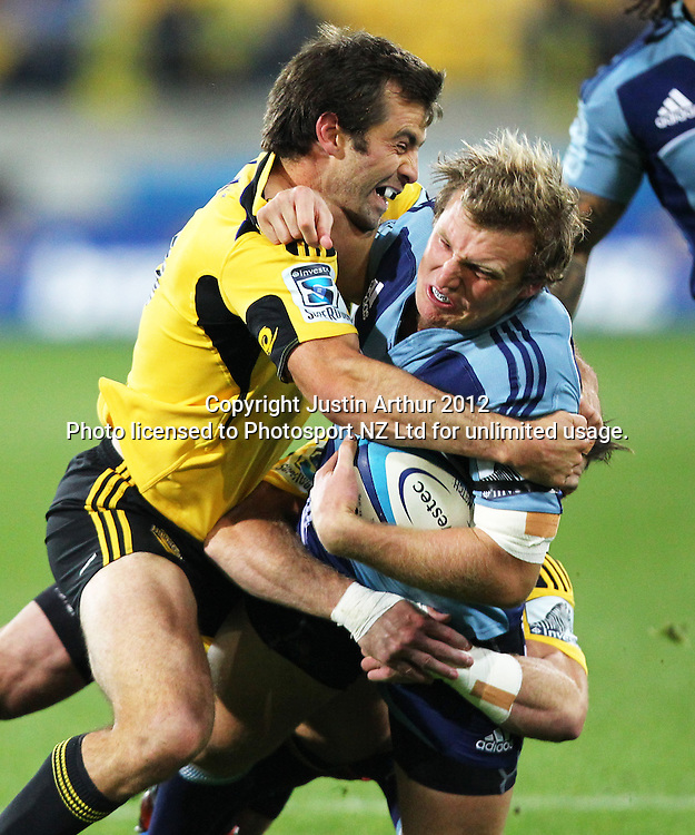 Blues' Hadleigh Parkes  is tackled by Hurricanes' Conrad Smith during the 2012 Super Rugby season, Hurricanes v Blues at Westpac Stadium, Wellington, New Zealand on Friday 4 May 2012. Photo: Justin Arthur / photosport.co.nz