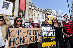 "© Licensed to London News Pictures. 17/08/2019. LONDON, UK.  Demonstrators in Trafalgar Square take part in a rally to show solidarity with the people of Hong Kong.  Similar ""Global Solidarity with Hong Kong"" rallies are taking place worldwide as protests in the former British colony enter their tenth week demanding democratic reforms and a halt to police brutality.  Photo credit: Stephen Chung/LNP"