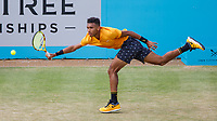 Tennis - 2019 Queen's Club Fever-Tree Championships - Day Six, Saturday<br /> <br /> Men's Singles, Semi Final: Felix Auger-Aliassime (CAN) Vs. Feliciano Lopez (ESP)<br /> <br /> Felix Auger-Aliassime (CAN) stretches to reach the shot on Centre Court.<br />  <br /> COLORSPORT/DANIEL BEARHAM