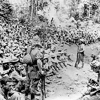 May 1942 - Prisoners and their Japanese captors during the Bataan Death March from Bataan to the Cabanatuan Prison Camp.