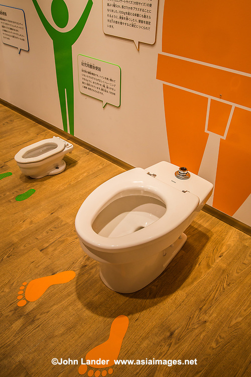 """Retro Toilets at Toto Toilet Museum - Japan makes some of the world's most sophisticated toilets. The TOTO Museum is devoted to the history of flush toilets in Japan. The museum's modern architectural design has a glowing white sheen and its no coincidence where that inspiration came from. The museum traces the history of traditional squat toilets, flush toilets, ever onwards up to high-tech Washlet equipped toilets. The company's history, beginning as a ceramics manufacturer, is laid out here in thoughtful displays. TOTO took a giant leap into the future in toilet technology when it introduced the country's first bidet-equipped toilet seat, known as the Washlet. This bidet/sprayer is now standard in more than half of Japanese homes. But never mind the glossy modern crappers: The highlight of the entire museum has got to be Neo, The Poop-Powered Toilet Motorcycle. Where else but Japan could a museum devoted to toilets be tasteful and fun?  Japan, and Toto in particular, is very candid and matter-of-fact about toilets, in contrast to other countries who make up euphemisms just to avoid even saying the word.  Excuse me, but I have to go visit """"the smallest room"""" now."""