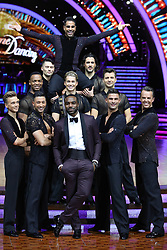 Presenter Ore Oduba (front centre) poses with AJ Pritchard, Joe Sugg, Johannes Radebe, Graziano Di Prima, Aljaz Skorjanec, Giovanni Pernice, Dr Ranj Singh, Pasha Kovalev and Graeme Swann during a photocall before the opening night of the Strictly Come Dancing Tour 2019 at the Arena Birmingham.