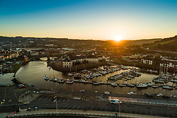 © Licensed to London News Pictures.10/10/2018. Aberystwyth, UK. Autumn dawn breaks over Aberystwyth harbour on the west wales coast, heralding a day of warm sunshine for much of the UK.  Photo credit: Keith Morris/LNP