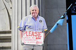 "© Licensed to London News Pictures. 22/04/2019. LONDON, UK. A cut out of broadcaster David Attenborough affixed to Marble Arch. Activists gather at Marble Arch during ""London: International Rebellion"", on day eight of a protest organised by Extinction Rebellion.  Protesters are demanding that governments take action against climate change.  After police issued section 14 orders at the other protest sites of Oxford Circus, Waterloo Bridge and Parliament Square resulting in over 900 arrests, protesters have convened at the designated site of Marble Arch so that the protest can continue.  Photo credit: Stephen Chung/LNP"