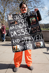 © Licensed to London News Pictures. 02/04/2016. London, UK. At a demonstration outside the US Embassy in London, a protester calls for the release of Steven Avery and Brendan Dassey, both jailed in connection with the 2005 murder of Teresa Halbach in Wisconsin, USA. The case was brought to prominence by the hit Netflix series 'Making a Murderer', which suggests the possibility of foul play in the arrest and convictions of the two men. Photo credit : Rob Pinney/LNP