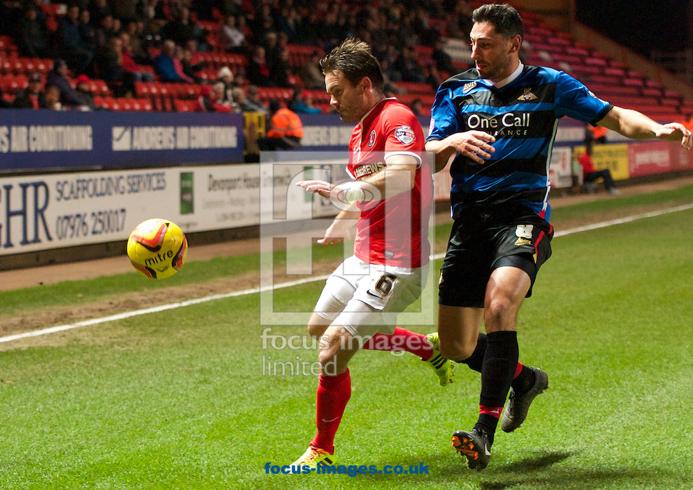 Picture by Alan Stanford/Focus Images Ltd +44 7915 056117<br /> 26/11/2013<br /> Dorian Dervite of Charlton Athletic and Billy Paynter of Doncaster Rovers during the Sky Bet Championship match at The Valley, London.