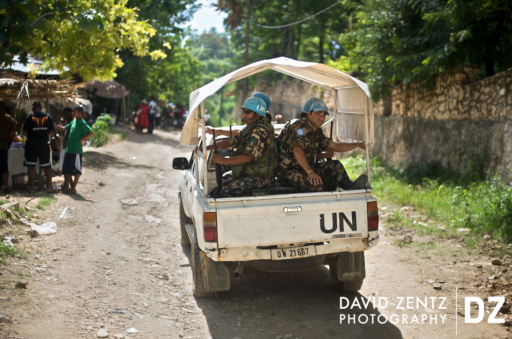 UN soldiers ride through the small village of Saut D'eau during the annual 3-day voodoo and Catholic pilgrimage held there on July 14, 2008 . The UN have been present throughout the country for more than a decade with the stated mission of helping the nation build its own police force while creating the security conditions necessary for the establishment of a functioning democratic govermnent.