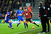 Jack Wilshire of AFC Bournemouth takes on Shinji Okazaki (20) of Leicester City and Riyad Mahrez (26) of Leicester City during the Premier League match between Bournemouth and Leicester City at the Vitality Stadium, Bournemouth, England on 13 December 2016. Photo by Graham Hunt.