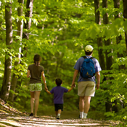 A man and his two kids hiking in Skinner State Park in Hadley, Massachusetts.  Holyoke Range.  Connecticut River valley.