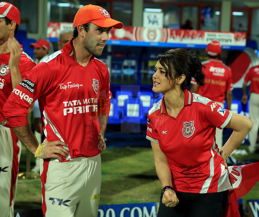 Glenn Maxwell of the Kings X1 Punjab and  Preity Zinta Owner of Kings XI Punjab after winning the  match 9 of the Pepsi Indian Premier League 2014 between the The Kings XI Punjab and the Sunrisers Hyderabad held at the Sharjah Cricket Stadium, Sharjah, United Arab Emirates on the 22nd April 2014<br /> <br /> Photo by Sandeep Shetty / IPL / SPORTZPICS