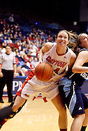 UD senior Justine Raterman (34) with the ball as the Rhode Island Rams play the University of Dayton Flyers at UD Arena in Dayton, Saturday, January 7, 2012.