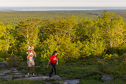 Siblings walking near the summit of Mount Agamenticus in York, Maine.