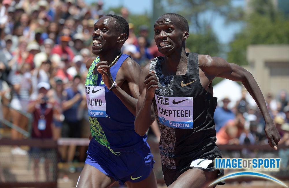 Jun 30, 2019; Stanford, CA, USA; Joshua Cheptegei (UGA) defeats Paul Chelimo (USA) to win the two mile, 8:07.54 to 8:07.59,during the 45th Prefontaine Classic at Cobb Track & Angell Field.