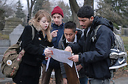 "December 5,2009- Director of Photography, senior Kristina Carucci, Director, junior Michael Bonner (center left), Production Manager, junior Tam Nguyen (center right) and First Assistant Director, junior Michael Rivera (right), consult a map while trying to find the location of the set for ""The Last Laugh"" at Mount Auburn Cemetery in Cambridge, MA. ""How many Emerson students, does it take to read a map?"" Rivera said jokingly afterwards. ""I know we're all film majors, but come-on."" The crew made up of all students from Emerson College in Boston, MA, is part of the club ""Frames Per Second,"" which helps to produce two student films a semester."