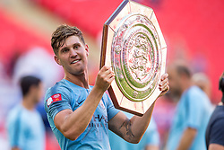 August 5, 2018 - John Stones of Manchester City lifts the Community Shield Trophy during the 2018 FA Community Shield match between Chelsea and Manchester City at Wembley Stadium, London, England on 5 August 2018. (Credit Image: © AFP7 via ZUMA Wire)