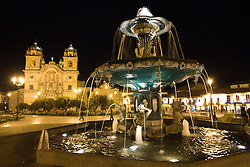Fountain in Plaza de Armas at night with Christian Cathedral in background; Cuzco city is a UNESCO World Heritage Site, Cathedral was built between 1559 and 1650, Cuzco, Peru, South America
