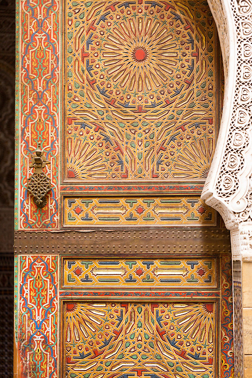 FEZ, MOROCCO - 16th DECEMBER 2015 - Old Moroccan doorway with intricately painted geometric patterns in the old Fez Medina, Morocco.