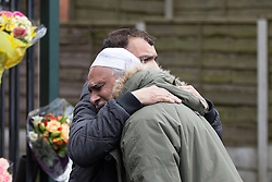 © Licensed to London News Pictures . 01/03/2016 . Manchester , UK . Shahzaib's Uncles MOHAMMED HUSSAIN and TARIQ HUSSAIN cry and hug outside the Masjid Hamza Mosque on Moss Lane West in Ashton Under Lyne , at the scene where 11 year old Shahzaib Hussain was killed by a hit and run driver yesterday evening (Monday 29th February 2016) . Photo credit : Joel Goodman/LNP