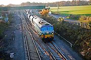 Diesel locomotive freight train on the West Coast mainline at Woodborough, Wiltshire, England, UK