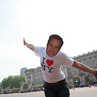 A tourist clad in a mask of PRINCE WILLIAM exults in front of Buckingham Palace days leading up to their royal wedding on April 29, 2011 in Westminster Abbey.