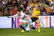 NEWCASTLE, NSW - NOVEMBER 13: Australian defender Ellie Carpenter (21) and Chilean defender Camila Sáez (18) come together at the international women's soccer match between Australia and Chile at McDonald Jones Stadium in NSW, Australia. (Photo by Speed Media/Icon Sportswire)