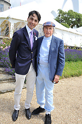 Left to right, FRANCOIS LE TROQUER and SIR JACKIE STEWART at a luncheon hosted by Cartier for their sponsorship of the Style et Luxe part of the Goodwood Festival of Speed at Goodwood House, West Sussex on 1st July 2012.
