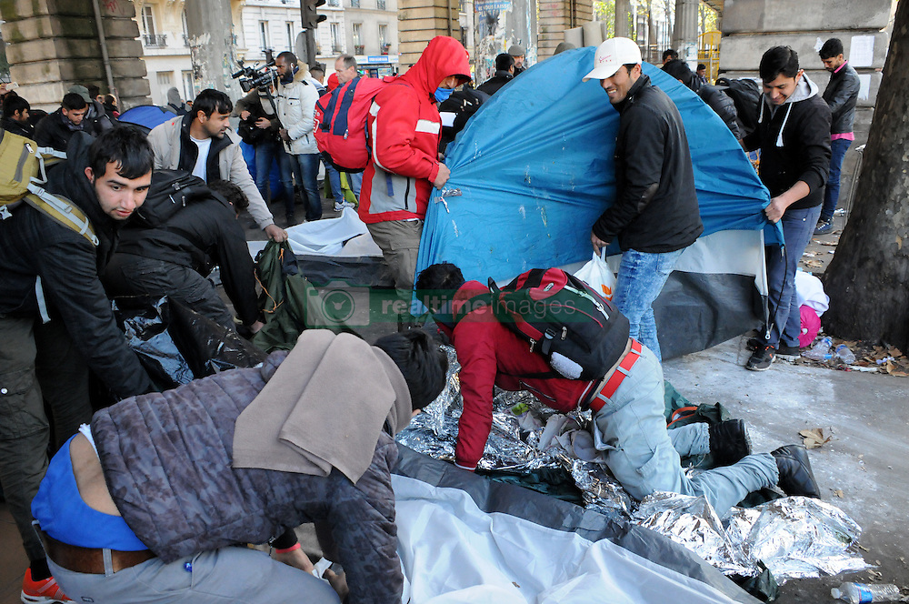 "Migrants carry their belongings at a makeshift camp at the Boulevard de la Villette, near the Jaures and Stalingrad metro stations, in northern Paris, France, on October 31, 2016, during a police operation aiming at a future evacuation of the camp. An operation of ""administrative control"" was underway on early October 31 in the Jaures/Stalingrad quarter before a future evacuation, whose date has not yet been set, according to a police source. The makeshift camp on the outskirts of the 10th and 19th arrondissements in the north of the capital numbers today 2,500 people, according to the City of Paris. Photo by Alain Apaydin/ABACAPRESS.COM"
