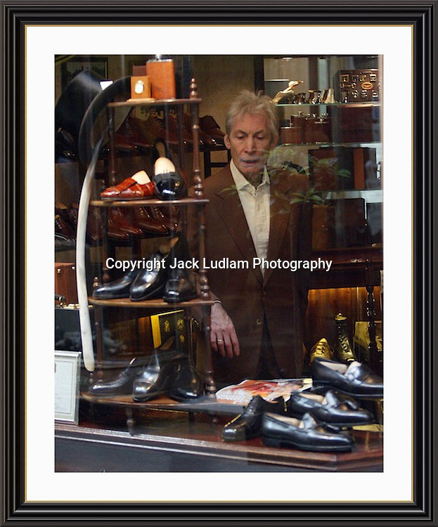 Charlie Watts Surveys The Hand made Steppers in Bond Street Arcade, High Quality Prints available ,please enquire via contact Page. Rights Managed Downloads available for Press and Media