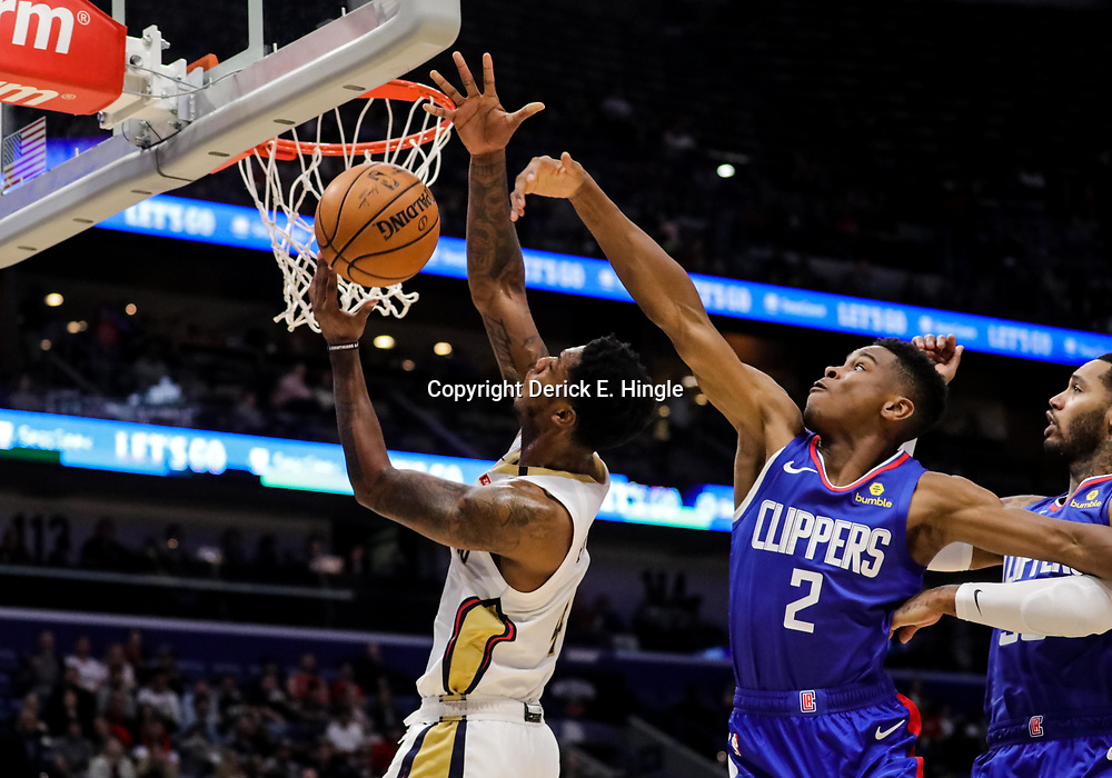 Oct 23, 2018; New Orleans, LA, USA; Los Angeles Clippers guard Shai Gilgeous-Alexander (2) blocks a shot by New Orleans Pelicans guard Elfrid Payton (4) during the first quarter at the Smoothie King Center. Mandatory Credit: Derick E. Hingle-USA TODAY Sports