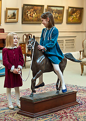 Sisters Clementine (4) and Eloise (6) from Edinburgh with a bronze of the Arabian Stallion Twaig, expected to fetch in excess of &pound;10,000 when it goes under the hammer at Bonhams sporting auction in Edinburgh this week.<br /> <br /> &copy; Dave Johnston/ EEm