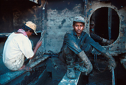 BANGLADESH CHITTAGONG MADHOM BIBIR HAT OCT00 - Gas-cutters pause during dis-assembly inside the hull of a decommissioned ship...Several thousand labourers work on one medium-sized (50,000 ton) ship for a period of around three months, until it is completely dismantled and taken apart. ..Since Bangladesh does not possess mineral resources such as iron ore, it works out more cost-efficient to employ a large army of day-labourers to recycle the scrapped ships rather than to import ore. On average, a labourer can expect to earn a little more than 1 US Dollar per day...jre/Photo by Jiri Rezac..© Jiri Rezac 2000..Contact: +44 (0) 7050 110 417.Mobile: +44 (0) 7801 337 683.Office: +44 (0) 20 8968 9635..Email: jiri@jirirezac.com.Web: www.jirirezac.com..© All images Jiri Rezac 2000 - All rights reserved.