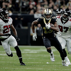 Dec 24, 2017; New Orleans, LA, USA; New Orleans Saints wide receiver Michael Thomas (13) runs after a catch past Atlanta Falcons cornerback Desmond Trufant (21) and defensive tackle Grady Jarrett (97) during the third quarter at the Mercedes-Benz Superdome. The Saints defeated the Falcons 23-13. Mandatory Credit: Derick E. Hingle-USA TODAY Sports