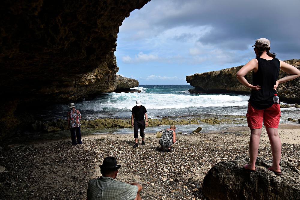 WILLEMSTAD, CURACAO - DECEMBER 12, 2014: A German tourists explore the coastline and hunt for seashells near the caves at Shete Boka National Park in Curacao's Westpunt region. (photo by Melissa Lyttle)