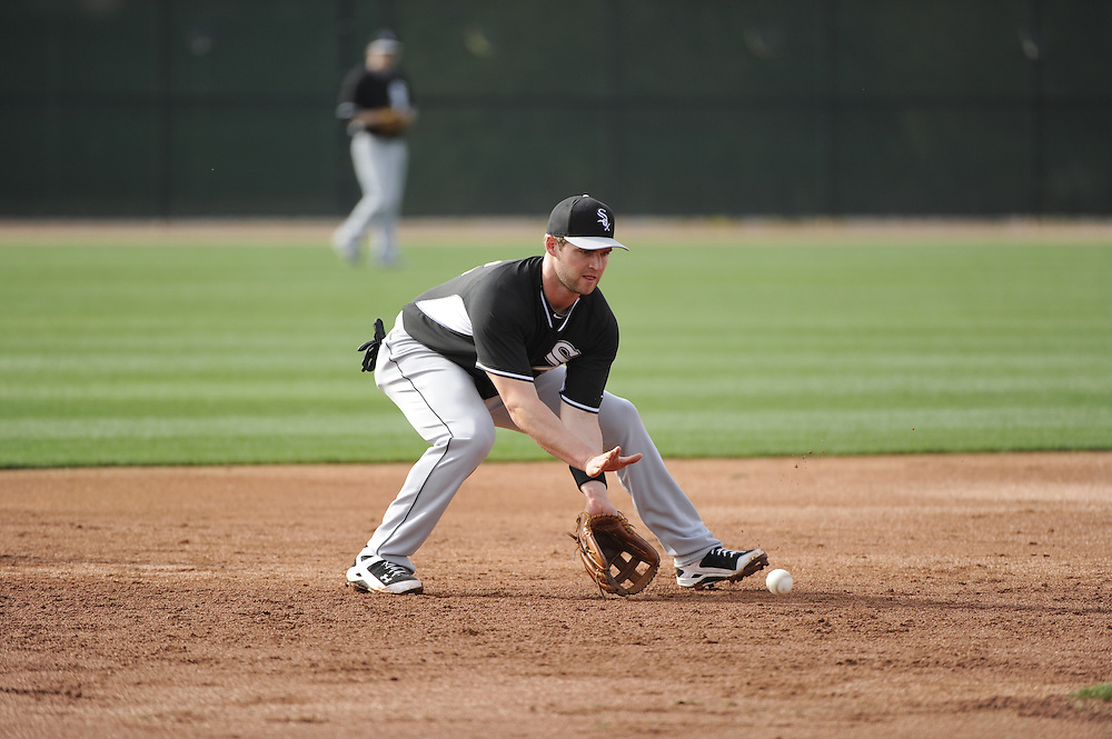 GLENDALE, AZ - FEBRUARY 19:  Matt Davidson #22 of the Chicago White Sox fields during spring training workouts on February 19, 2014 at The Ballpark at Camelback Ranch in Glendale, Arizona. (Photo by Ron Vesely)   Subject: Matt Davidson