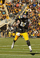 November 23 2013: Iowa Hawkeyes quarterback Jake Rudock (15) throws a 5 yard touchdown pass during the first quarter of the NCAA football game between the Michigan Wolverines and the Iowa Hawkeyes at Kinnick Stadium in Iowa City, Iowa on November 23, 2013. Iowa defeated Michigan 24-21.