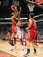 Feb. 9, 2012; Phoenix, AZ, USA; Houston Rockets forward Luis Scola (4)  puts up a shot against the Phoenix Suns forward Channing Frye (8) during the first half at the US Airways Center. The Rockets defeated the Suns 96-89. Mandatory Credit: Jennifer Stewart-US PRESSWIRE.