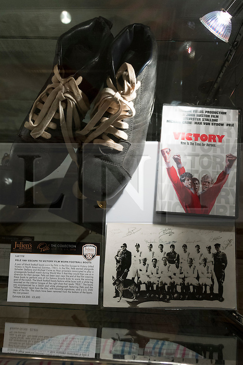 © Licensed to London News Pictures. 01/06/2016. The original football boots Pele wore in the film Escape To Victory. Pele: The Collection with over 1,500 items of memorabilia owned by Pele for sale on later in June. London, UK. Photo credit: Ray Tang/LNP