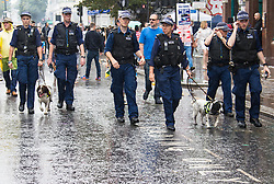 London, August 28th 2016. Police patrol with sniffer dogs as Europe's biggest street party, the Notting Hill Carnival gets underway.